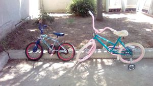 Kids bike 35 Bolt they are in good conditions one of them has it training wheels for Sale in Woodlake, CA
