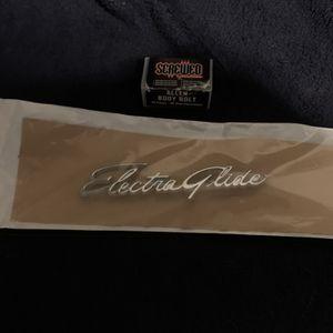 Harley OEM Electraglide Fender Emblem Original In Original Package for Sale in Seattle, WA