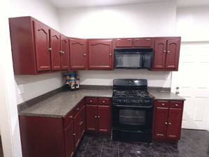 Happy costumer with his new kitchen cabinets in Cherry stain color, bathroom cabinet in dark stain color. for Sale in Los Angeles, CA