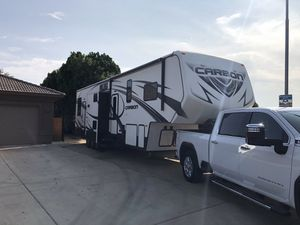 2015 Carbon M-377 triple slide toy hauler - 1.5 bathrooms - 12' garage for Sale in Peoria, AZ