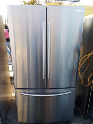 Samsung french door refrigerator/3 month warranty and free local delivery for Sale in San Fernando, CA
