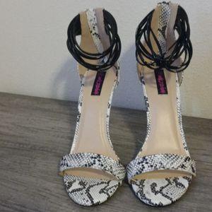 Wild diva black and white snakeskin design heels for Sale in Austin, TX
