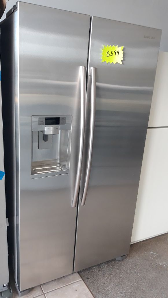 Samsung stainless steel side by side refrigerator excellent condition
