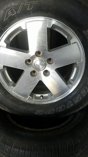 Jeep wheel 18. With tire on sale for Sale in Houston, TX