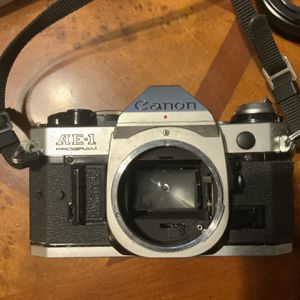 Cannon AE1 With lens And In Addition A Sakar 75-300 Zoom Lens for Sale in Boynton Beach, FL