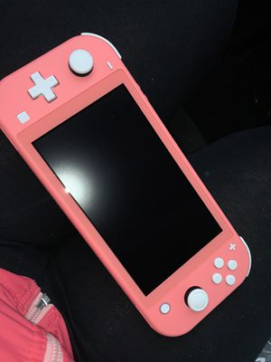 Nintendo switch lite coral for Sale in Laurel, MD