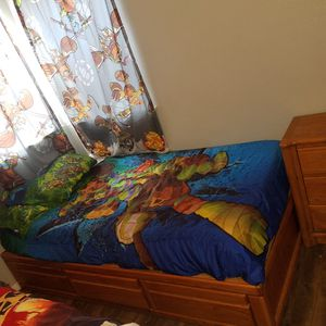 Twin bed frame with 3 drawer and Night stand as dresser,solid& havy material, Brown light color,matress is not incluide,pick up only, cash only. for Sale in Austin, TX