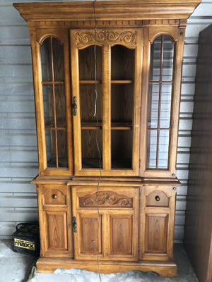 Wooden China cabinet w/ integrated light fixture. for Sale in Peyton, CO