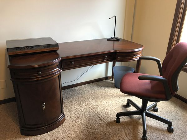 Cherry desk 60 inches wide 25 inches deep. with Chair and floor Lamp