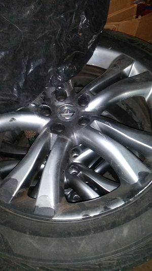 Nissan factory 20inch rims and tires in decent shape for Sale in Chicago, IL