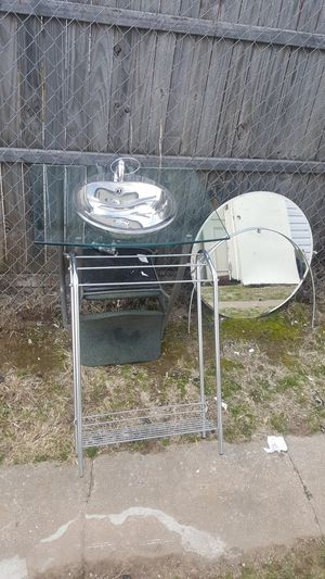 Rapsel tempered glass wall mount sink 33 by 23 in. with 30 by 30 hanging mirror and towel rack for Sale in Tulsa, OK