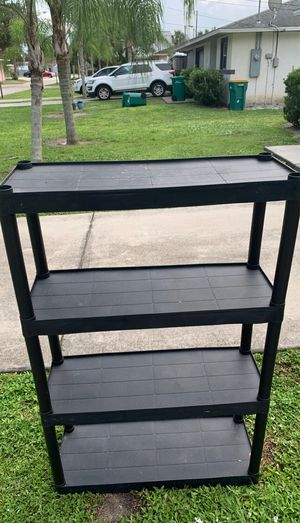 Nice plastic shelves for sneaker and safe space in the garage neat to be organized with plastics just added for 2$eat for Sale in Melbourne, FL