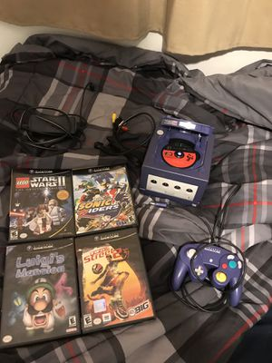 Nintendo gamecube with original controller, luigi's mansion, sonic riders , star wars, fifa street 2 and driver with orinal cases for Sale in Miami, FL