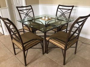 Wrought Iron Dining Table with Four Upholstered Chairs for Sale in Palm Harbor, FL