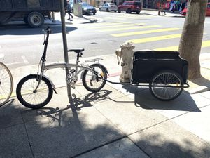 foldable bike w/ new foldable trailer for Sale in San Francisco, CA