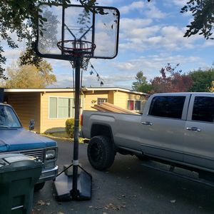 FREE , Basketball Hoop. used still in great shape. small crack on edge of backboard. and its adjustable. FREE for Sale in Federal Way, WA