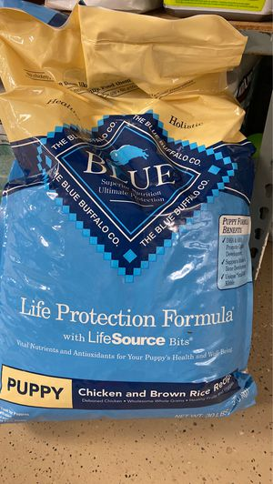 Blue Buffalo puppy chicken and brown rice 30 pound bag for Sale in Nuevo, CA