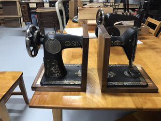 Antique sewing machine bookends and tractor for Sale in Warrenton,  VA