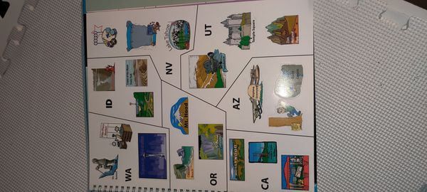 Atlas book. Stickers and cd never used. Wall map used but never written on(laminated giant wall map)