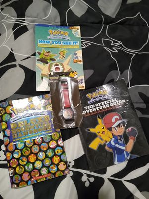 Pokemon lot 3 books and an old unopened lcd watch for Sale in Austin, TX