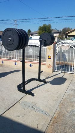 700lbs capacity 7 foot Olympic barbell with 230lbs bumper plate set and Squat rack NEW for Sale in Montebello,  CA