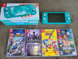 Nintendo switch lite with 4 games for Sale in Carrollton, TX