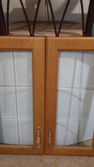 Beautiful Oak and glass etched kitchen cabinet doors single doors 12 in double will be 24 bigger doors AR-15 double would be 30 all are 24 in high for Sale in Ocean Gate, NJ