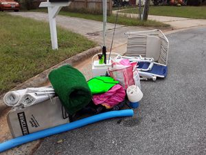 Free assorted pool accessories floats balls rings. 2 LawnChairs for Sale in Greensboro, NC