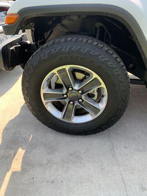 Original Jeep Wheels and Bridgestone Dueler Tires for Sale in Montclair, CA