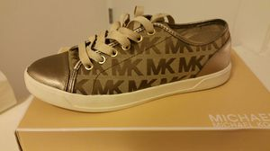 Michael Kors bronze color sneaker size 9 for Sale in Reisterstown, MD