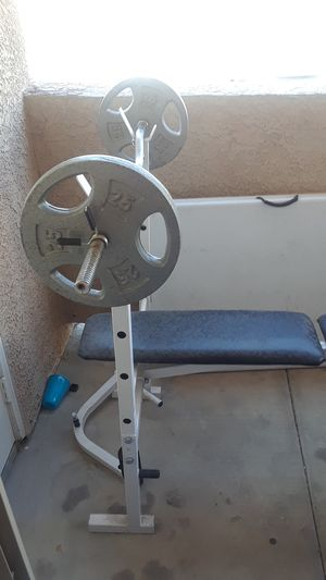 Weight bench with curl bar and two 25 inch weights for Sale in Las Vegas, NV