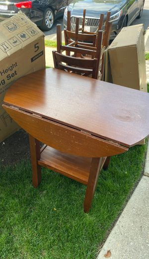 Free Wood table and 4 chairs for Sale in Gambrills, MD