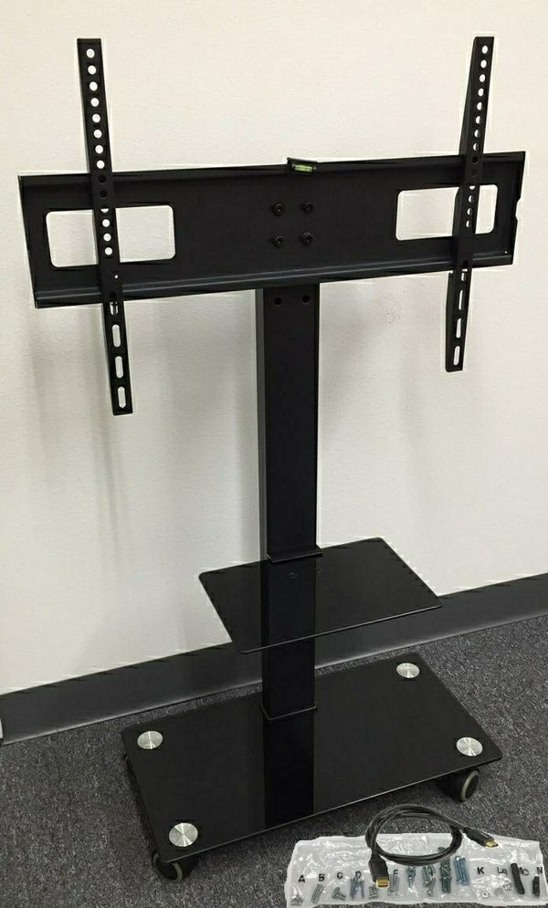 New in box 11x26x43 inches tall 32 to 65 inches tv television stand with wheels 90 lbs capacity