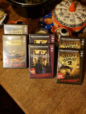 Great hollow Wayne video movies for TV or to your window or wall Comes with bonesy desk with all of the movies for Sale in Indianapolis, IN