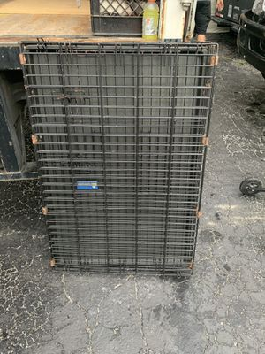 Dog kennel in good shape large size for Sale in New Port Richey, FL