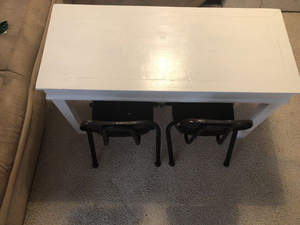 Toddler table and two black chairs