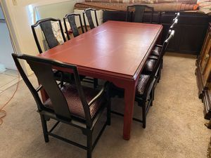 Asian 8 chairs wooden dining table. With leather seat Has 4 arm chairs and 4 armless Very good condition. Only small color scratches you can se for Sale in Las Vegas, NV