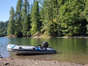 Polaris inflatable boat with 15 horse Mercury engine and trailer for Sale in Vancouver, WA