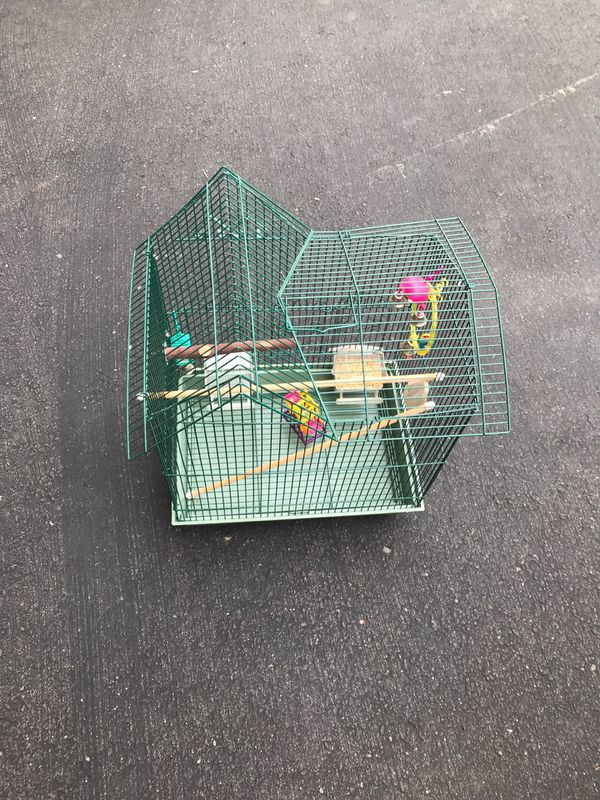 Parakeet cage, includes feeder dishes and all accessories.