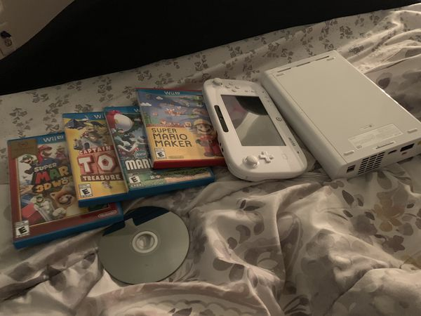 White Wii U. With a few games must go