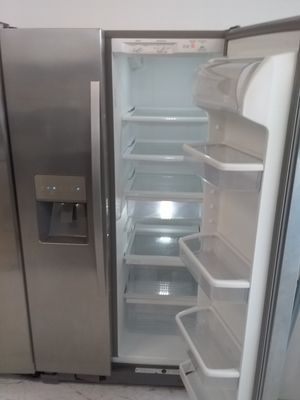 Ge side by side stainless steel refrigerator used good condition 90days warranty for Sale in Mount Rainier, MD