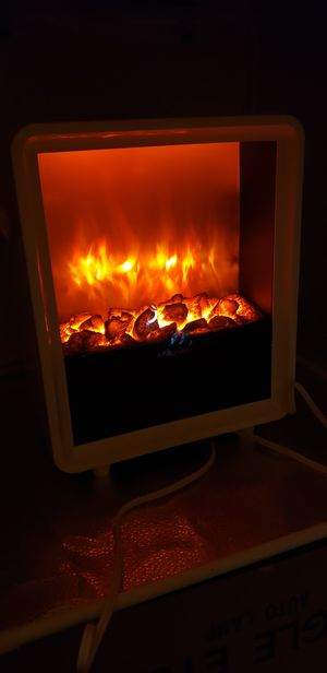 "New Pura Flame Electric heater ,Timer & 4 settings,1500 W, 15""H/12W/9D, Heats 400 Sq. ft. for Sale in Las Vegas, NV"