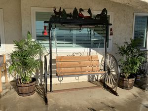 Wagon wheel porch swing for Sale in Riverside, CA