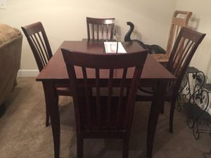 Wooden kitchen table with 4 chairs / kids dinning table. for Sale in Nashville, TN