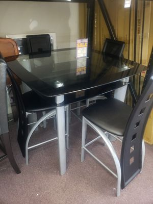 Table and 4 chairs counter height firm price for Sale in Orlando, FL