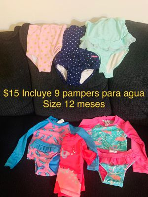 Baby girl swimming outfit with 9 swimming pampers included for Sale in Washington, DC