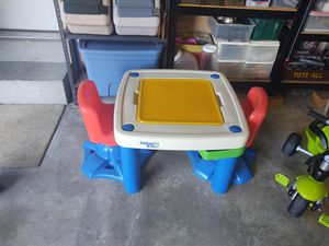 Table combo with reversible table top for Legos and 2 storage compartments. Chairs also swivel for Sale in Florissant, MO