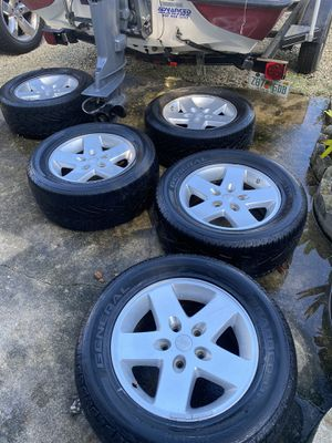 Jeep wheels 17 inch in like new condition I have 5 of them and will take $125 for all five for Sale in New Smyrna Beach, FL
