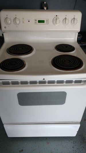 GE electric stove and hot point over counter microwave for Sale in Christiana, TN