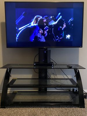 LG 55 INCH SMART TV WITH 50 INCH WIDE BLACK AND GLASS TV STAND for Sale in Mesquite, TX